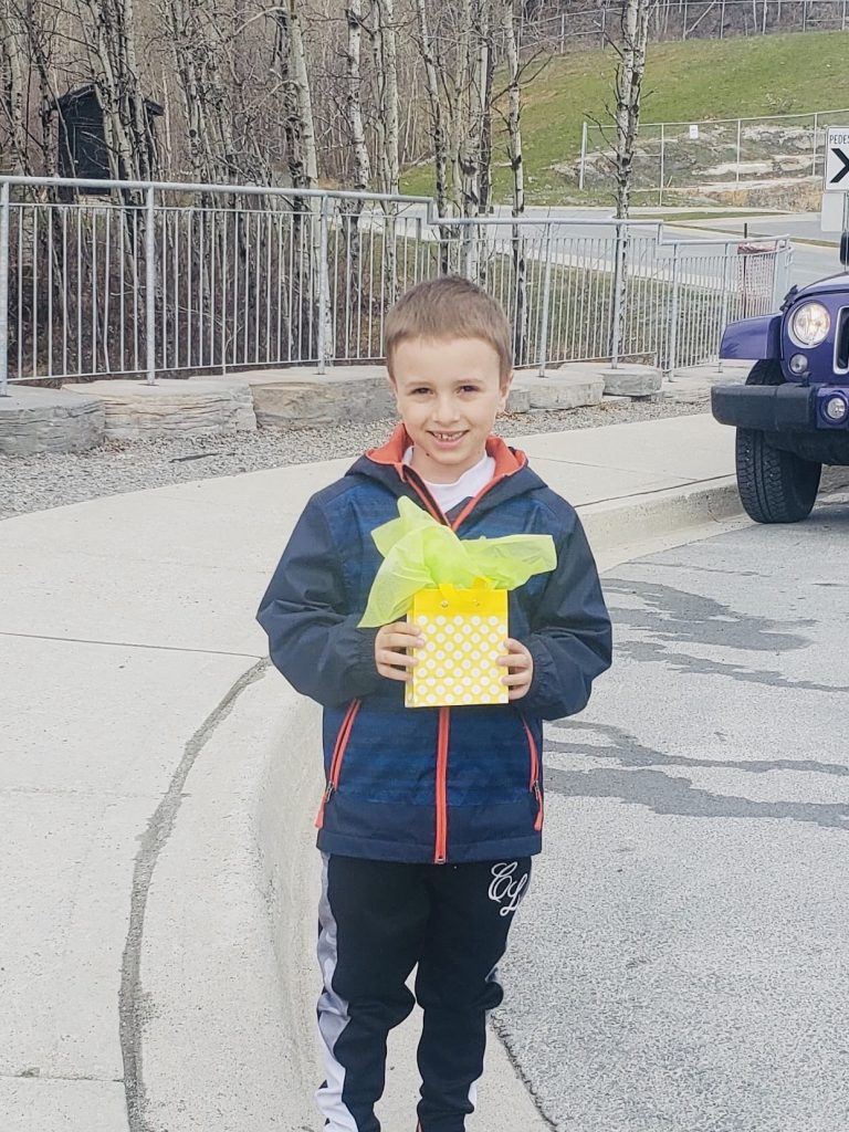 Boy holds up his gift